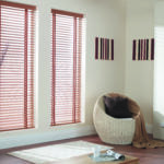 chestnut venetian window blinds covering large windows in a modern living room