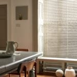 venetian window blind covering large window in dining room