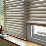 close up of a beige grey venetian window blind