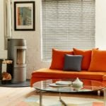 light grey venetian window blind covering a window in a modern industrial living room