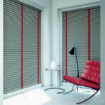 light grey venetian window blinds with contrasting red tapes