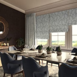 light grey/silver coloured roman window blinds with a fern print fabric covering windows in a traditional dining room of a country house
