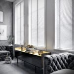 white venetian window blinds with cotton coloured tapes covering large windows in a modern living room