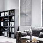grey venetian window blinds covering windows in a modern monochrome styled living room