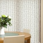 vertical window blind with floral pattern