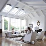 navy velux roller window blinds covering ceiling windows in a timber framed large living room