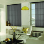 light charcoal vertical window blinds covering two window in a modern living room