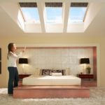 velux roller window blinds cover velux windows in a modern bedroom