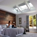 grey velux window blinds in a bedroom