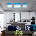 blue velux window blinds in a modern open plan kitchen/living room
