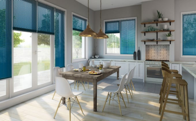 bright turquoise venetian window blinds covering multiple windows in a bright modern kitchen
