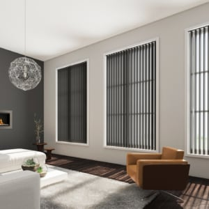 graphite coloured vertical window blinds covering multiple large windows in a modern living room